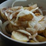 sausage and potato salad in a cream bowl