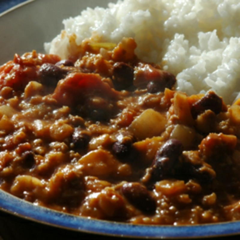 chilli mince, with white rice, on a blue plate